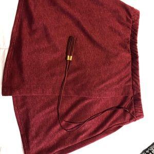 Maroon tie across skirt